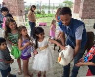 Kids petting duck