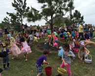 Kids playing Easter egg hunt